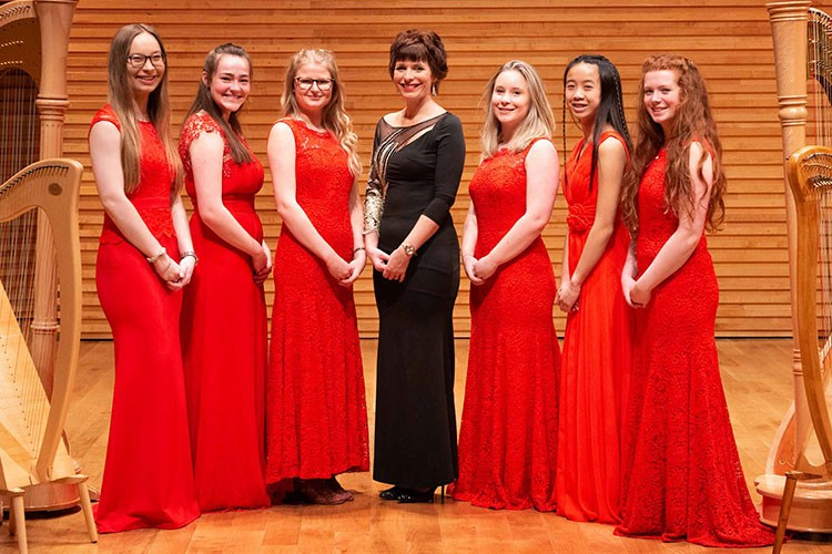 Lusia Cordell (conductor) with orchestra leaders
