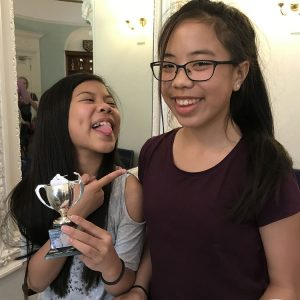 Photo of Sasha & Yasmin Ng with their shared trophy